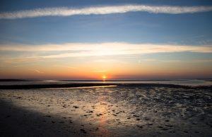 Sonne über dem Watt bei Norderney