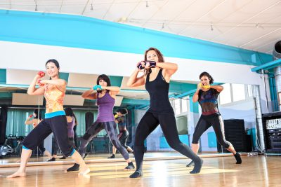 a group of women in sport dress at piloxing exercise